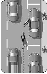 Image showing bicyclist riding far enough away from a parked vehicle to avoid being hit by an opening door.